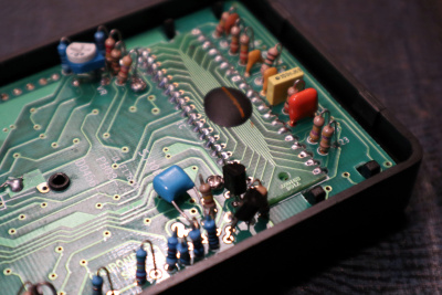 An ICM7106 epoxy blob on a 40-pin DIP-shaped PCB