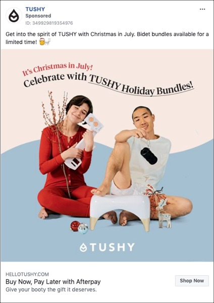 A colorful Tushy Facebook ad with a Christmas in July theme, two people holding items from the company, advertising Tushy Holiday Bundles.